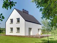 Dom wzorowany na wiejskiej zagrodzie