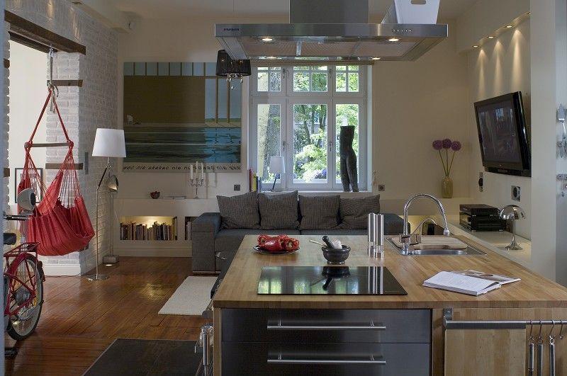 Radzimy, jak urządzić kuchnię połączoną z salonem